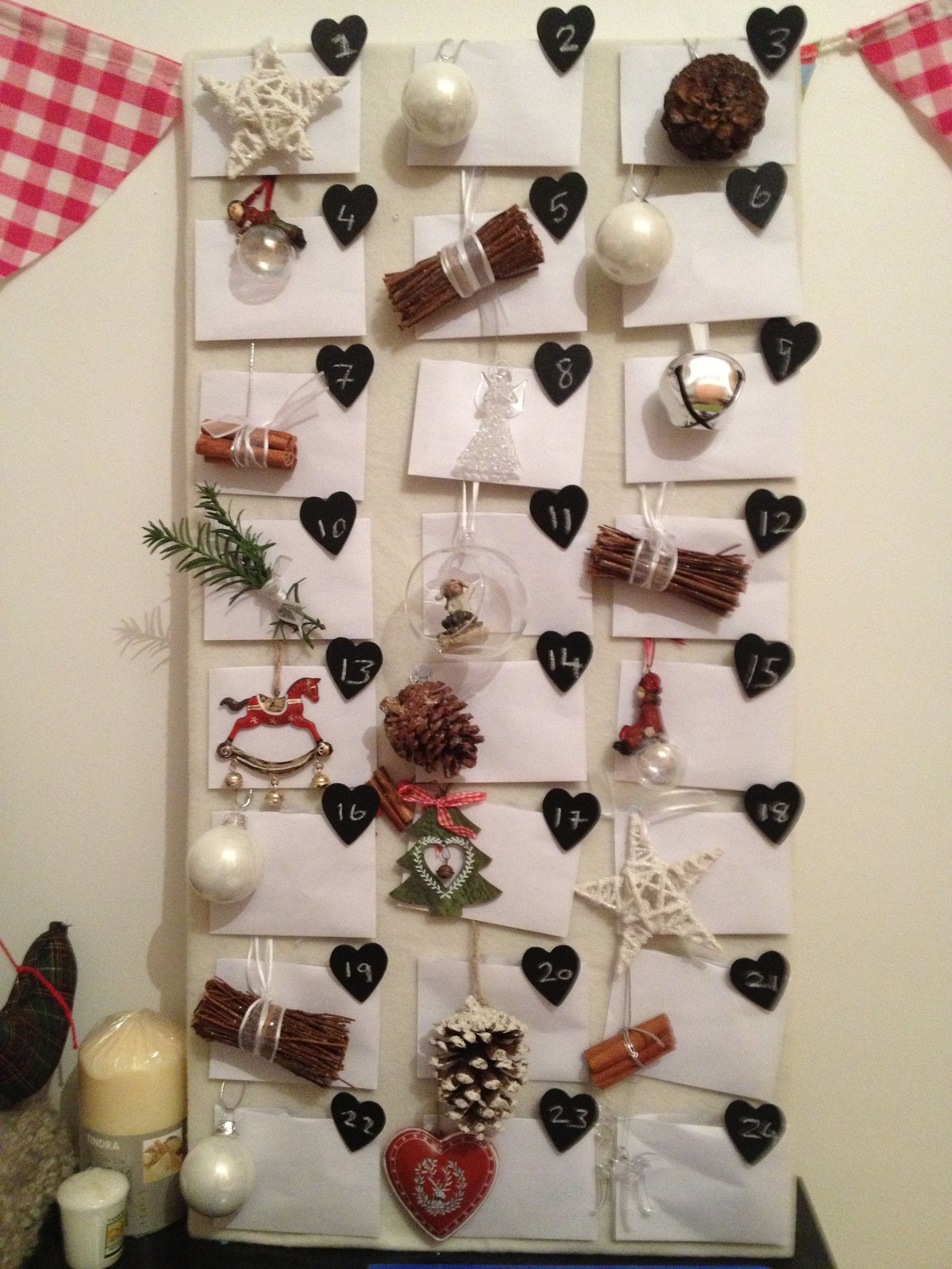 Homemade advent calendar!!   Made from material, Christmas baubles and homemade baubles attached to envelopes which inside have fun voucher activities or Christmas facts/jokes! My girlfriend loves it!