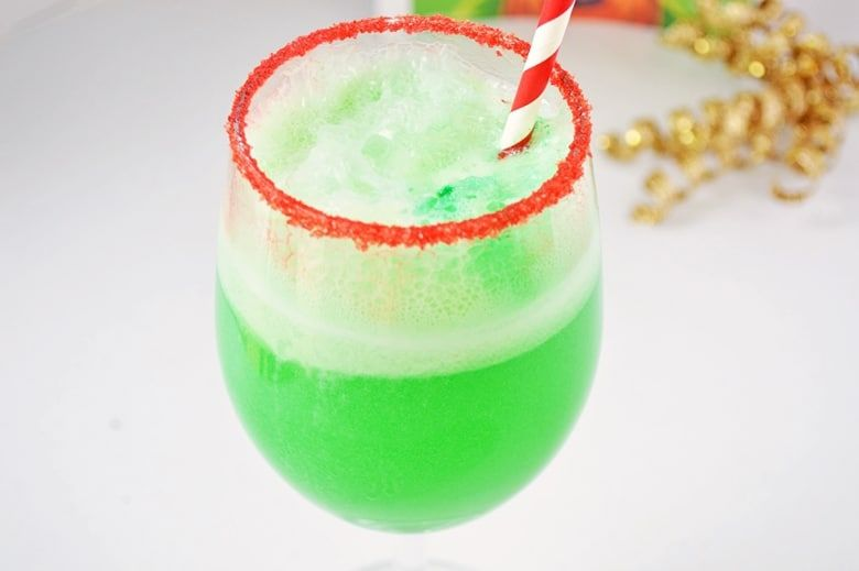 This small-batch Grinch Punch recipe made with Hawaiian Punch, Sprite and lime sherbet is a perfect drink for the kids on Christmas. #grinchpunchrecipe