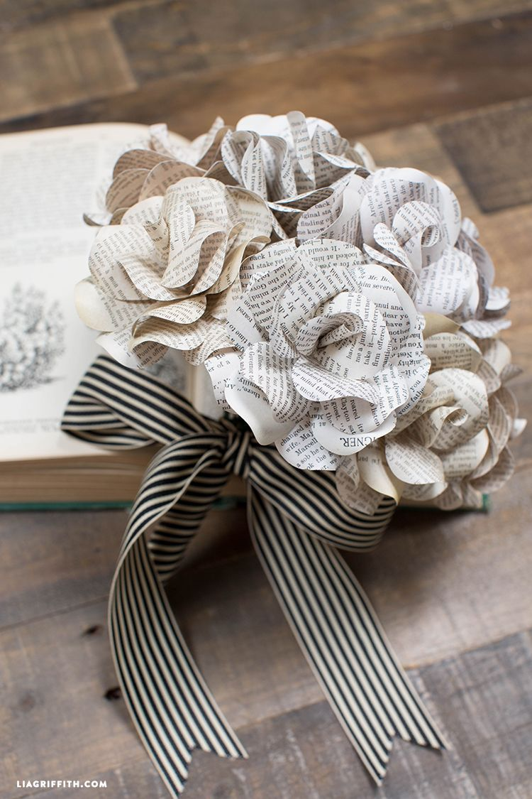 Vintage book page flowers diy paper vintage books and rose this super creative bouquet of paper flowers is made with vintage book pages makes for an interesting statement piece template and tutorial by lia griffith mightylinksfo