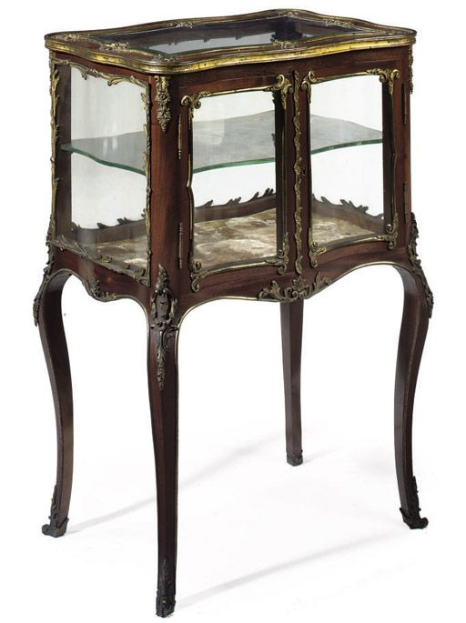 A FRENCH GILT-METAL MOUNTED MAHOGANY VITRINE CABINET In the Louis XV
