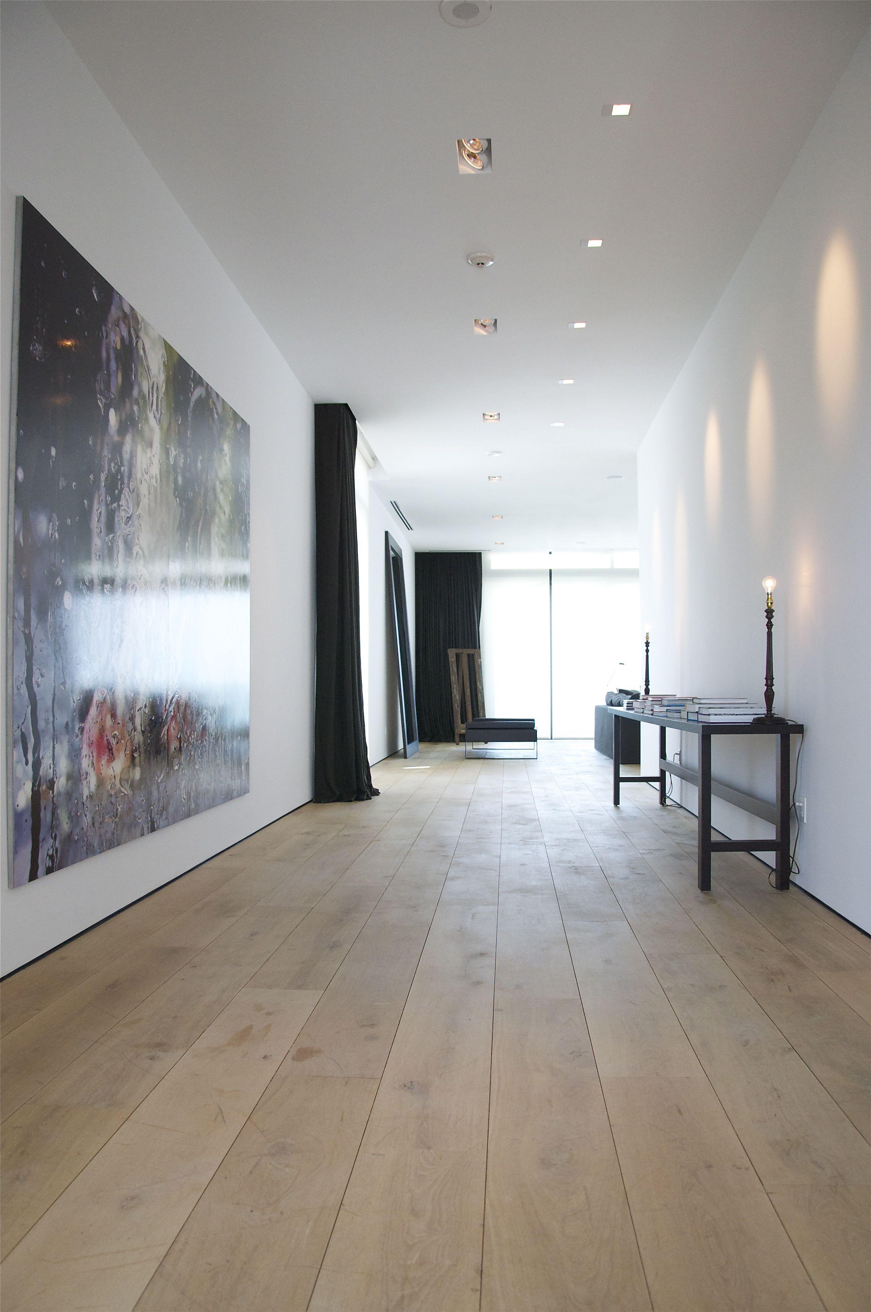 GOOD bones...wide plank wood flooring...space....art...& fabulous lighting.....gimme some...please <3