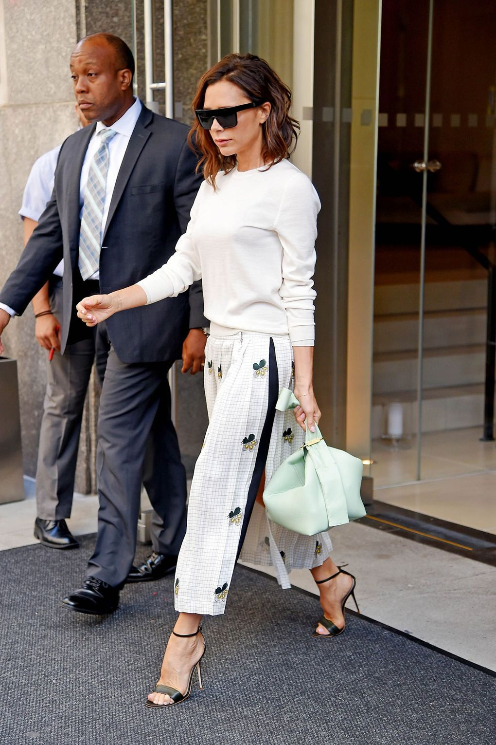 Spotted out and about in New York, Victoria wore white military culottes paired with stilettos.