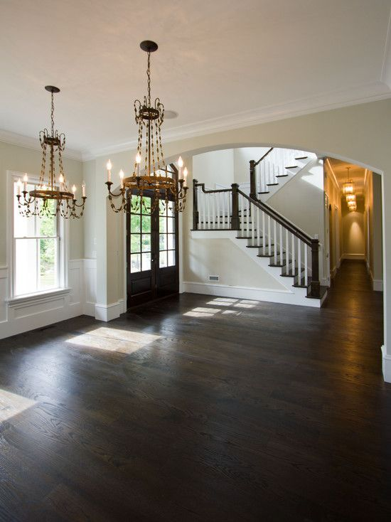 I think dark hardwood floors like this in the foyer