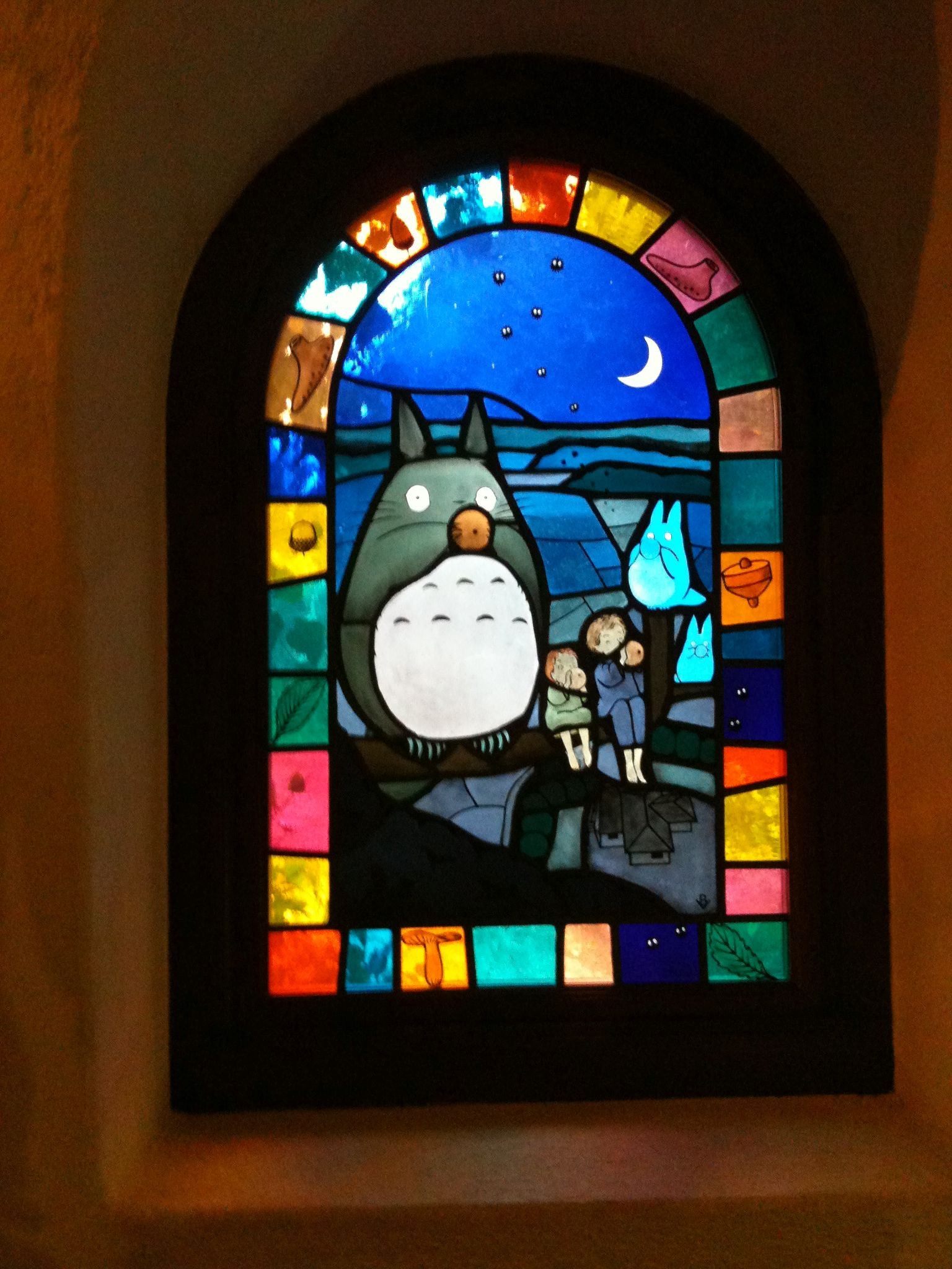 Stained glass windows everywhere inside the Ghibili Museum, even in the toilets. Whimsical lovely place!