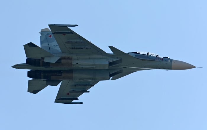 Watch Russian Su-27 Jets Escort Belgian F-16 Fighter Over the Baltic Sea