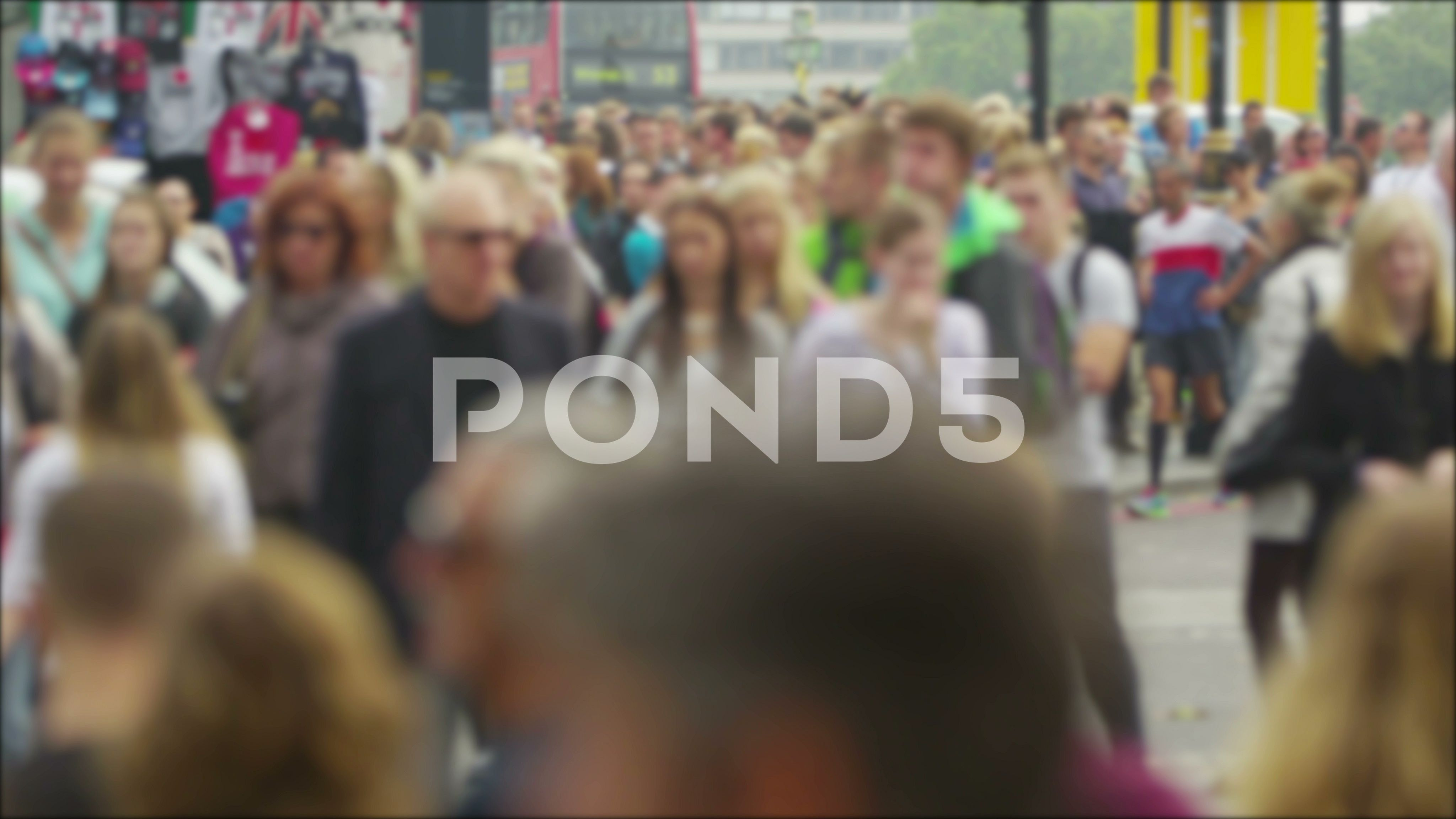 LONDON - Diverse crowd of people walking through the city