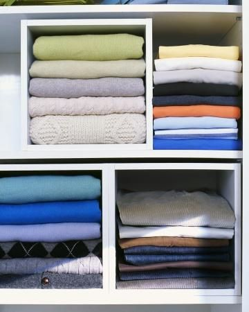 Open Storage Cubes Rein In Piles Of Folded Shirts And