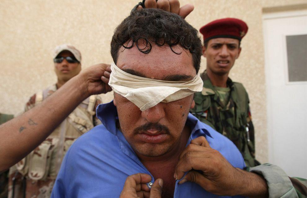 Las fuerzas de seguridad iraquíes arrestan a un hombre sospechoso de ser de Al-Qaeda en activista chií-suní barrio Jihad de Bagdad, anteriormente controlada por Al-Qaeda