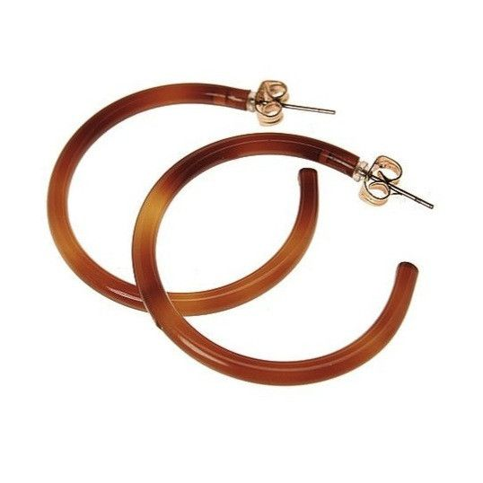 These bohemian-inspired, tortoise shell hoop earrings are perfect for work, weekends, and dinner dates.