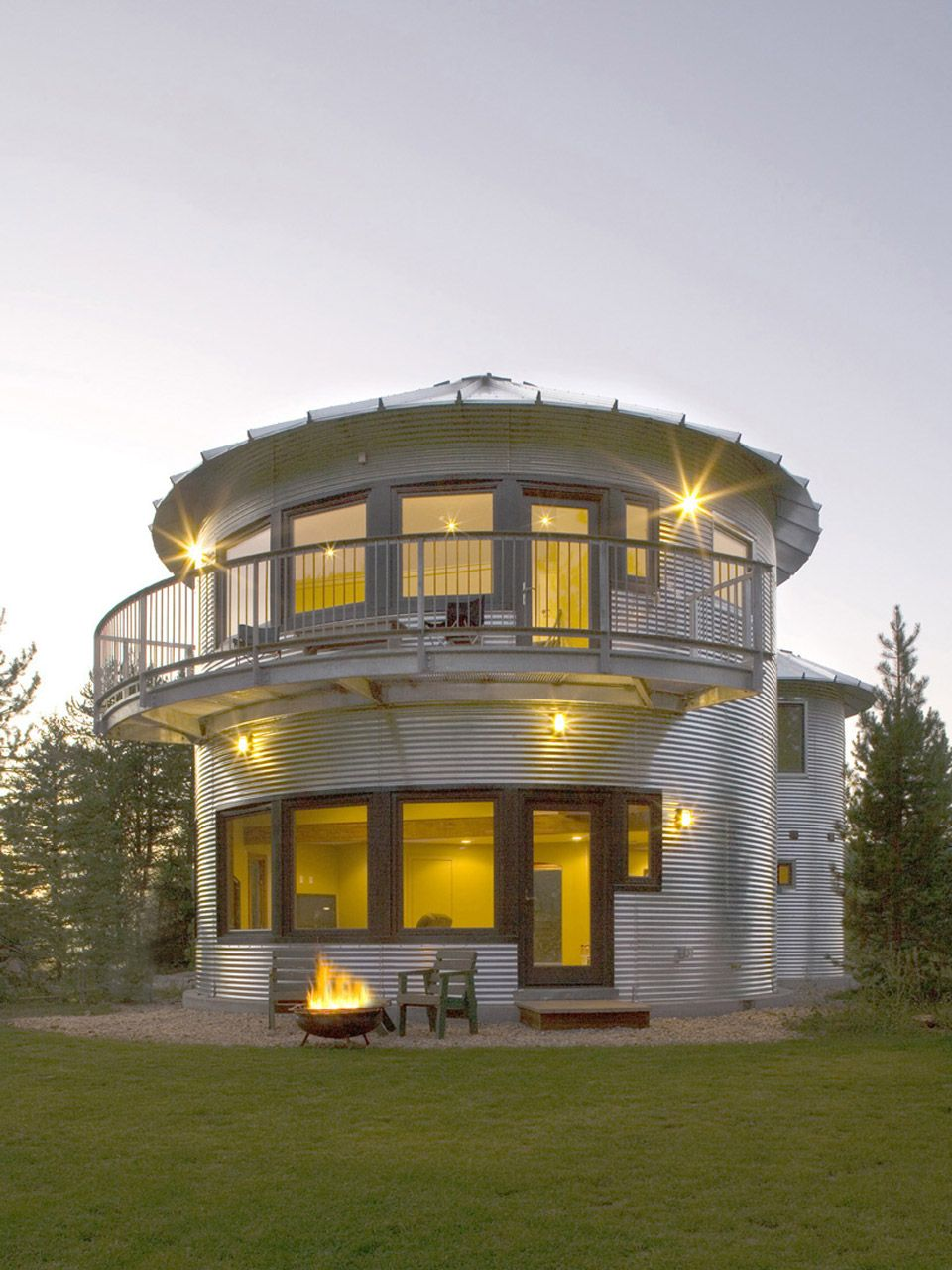 Awesome grain silo house - love the cubby bunks, the balcony and windows!