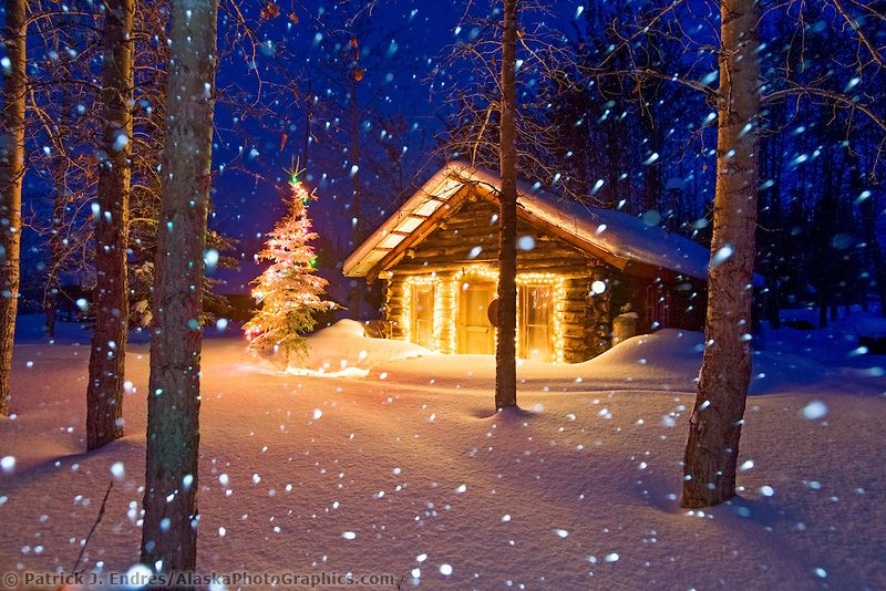Winter Scene Of Heavy Falling Snow And A Historic Log Cabin With - Christmas cabin fireplace scenes