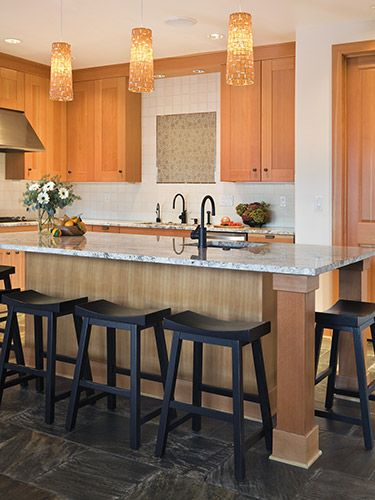 Crowd Your Cocina and make it more inviting by adding lots of seating.