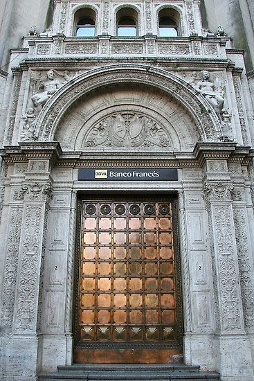 Copper door by Maggie Hegarty  The buildings in Buenos Aires certainly have style, such as the detailed carving and the beautiful copper door on this bank.