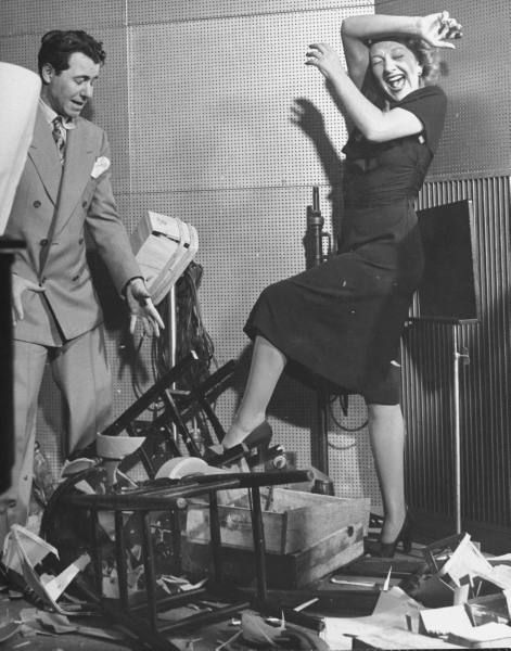 actress gertrude lawrence and her sound effects guy on stage at her radio show - Old Time Radio Christmas
