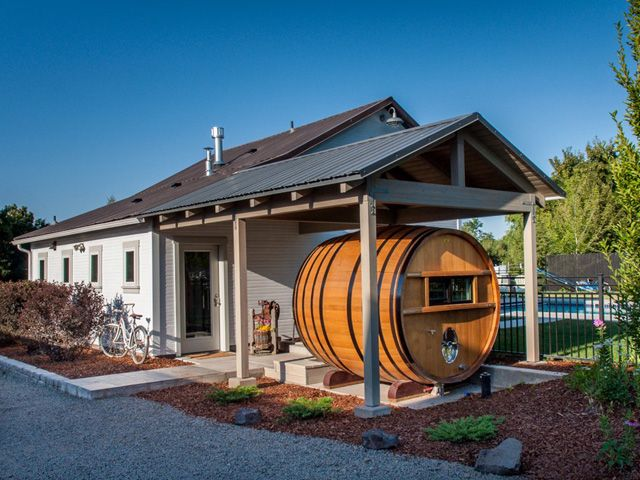 This two-bedroom home boasts an airy, open concept layout, but it also includes an additional sleeping area on the patio: a wine barrel that once housed more than 1,000 gallons of wine.