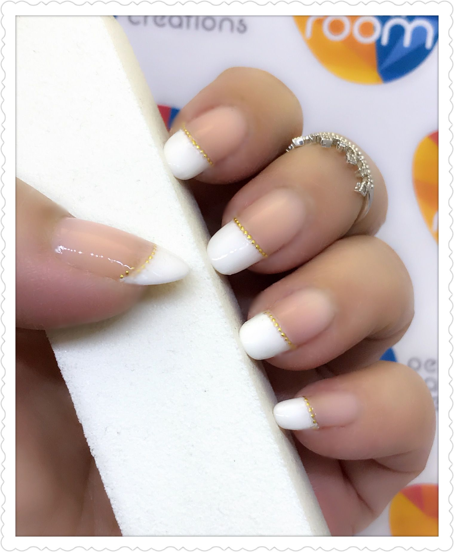 French tip with gold beads outline using nail sticker. Products used ...