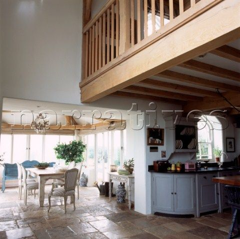 open plan country kitchen dining room with mezzanine and stone