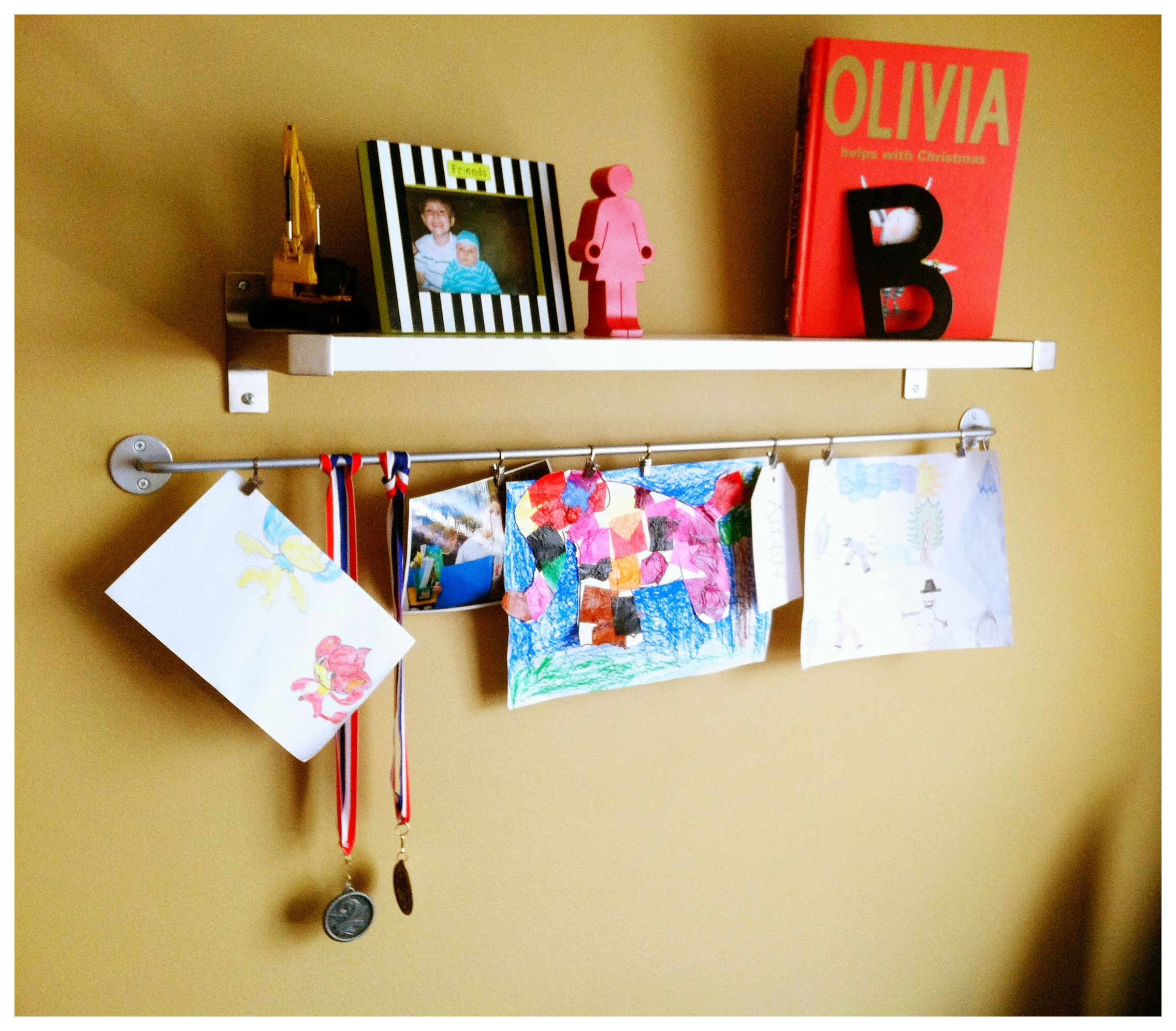 Ikea bookshelf and kitchen utensil shelf, used to hang kids artwork ...