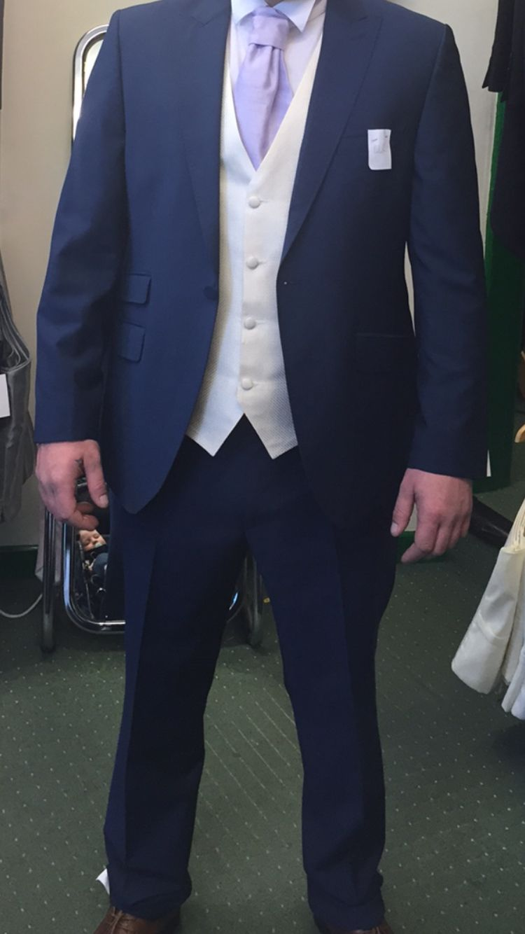 Blue suit, Ivory waistcoat and lilac cravat. For the Groom and son :)
