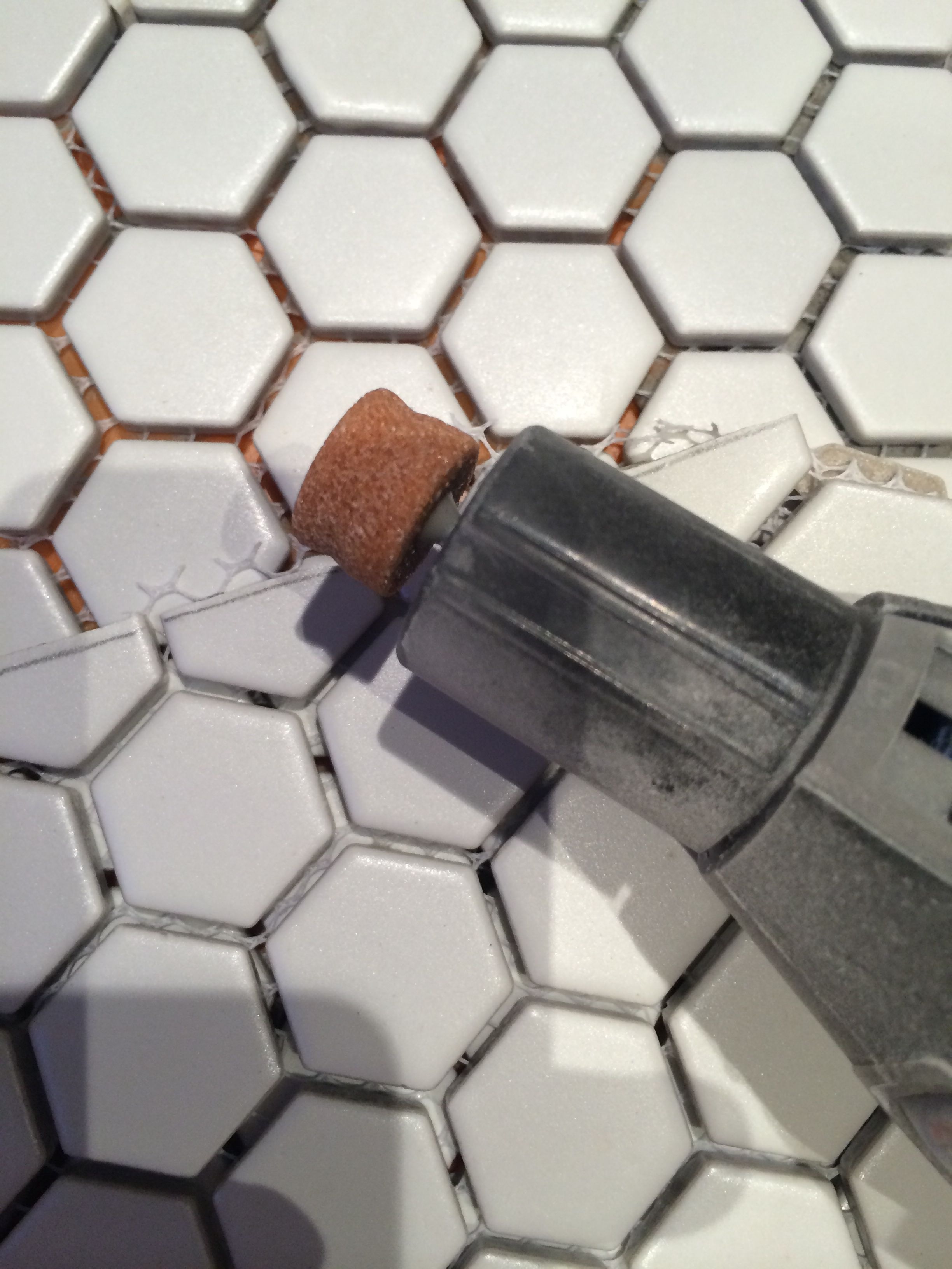 Use Dremel Grinder To Make The Mosaic Straight And Smooth Along Top Edge
