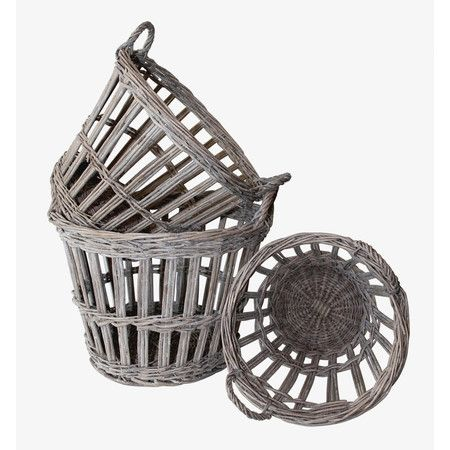 Stow throw pillows in the den or out-the-door essentials in the foyer with these French-style baskets, showcasing an open weave design and dual handles.