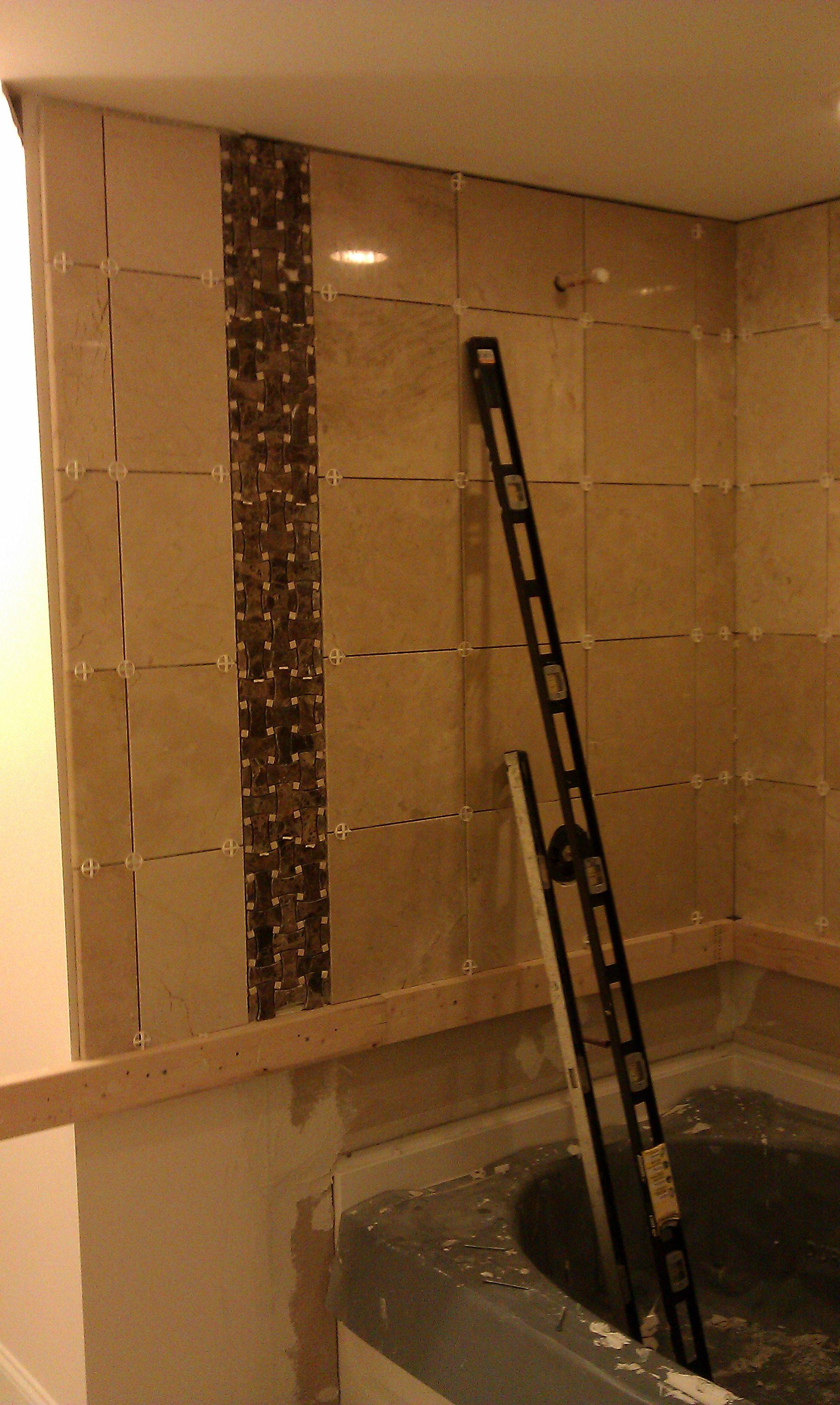 Setting marble tile on wall above bathtub. | Floor & Wall Tile ...