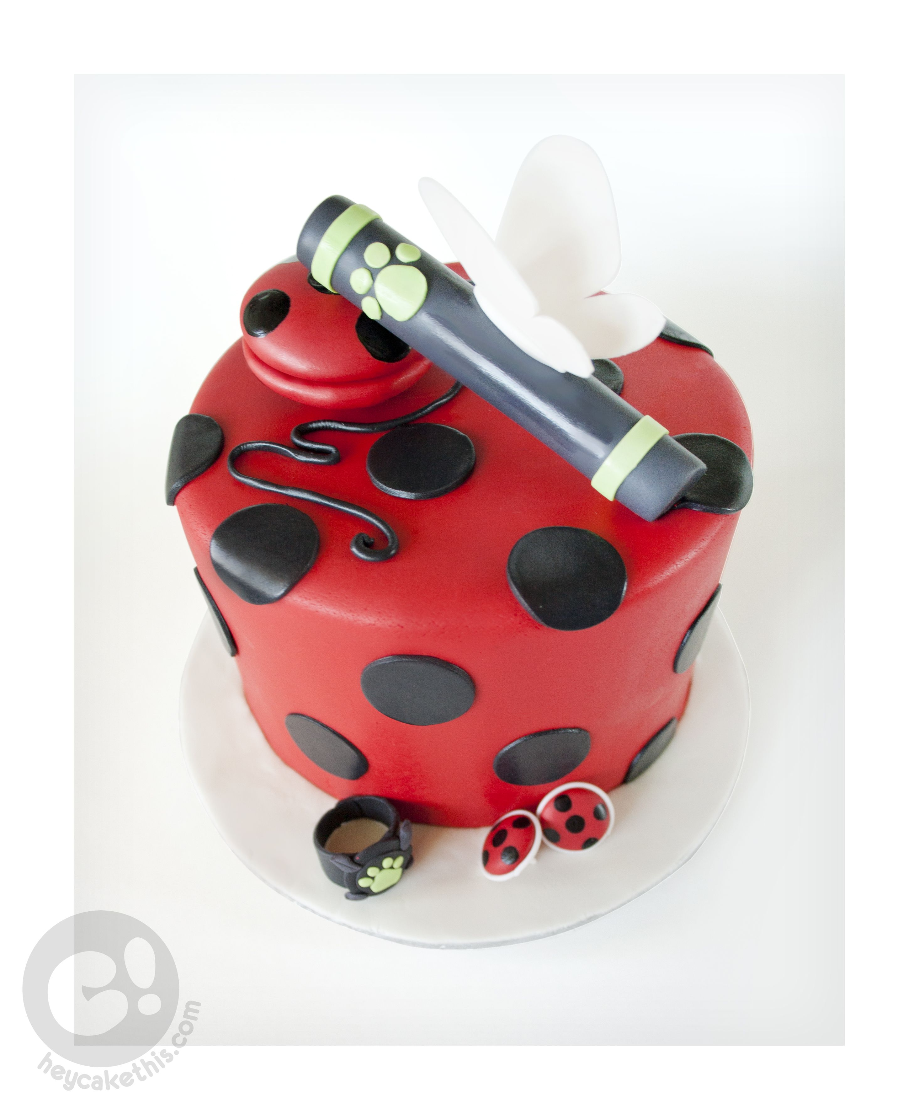 A cake themed after the cartoon Miraculous Ladybug and Cat Noir