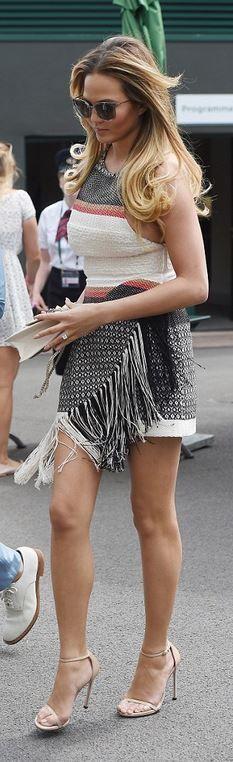 Who made Chrissy Teigen's nude sandals, studded handbag, and red stripe fringe dress?