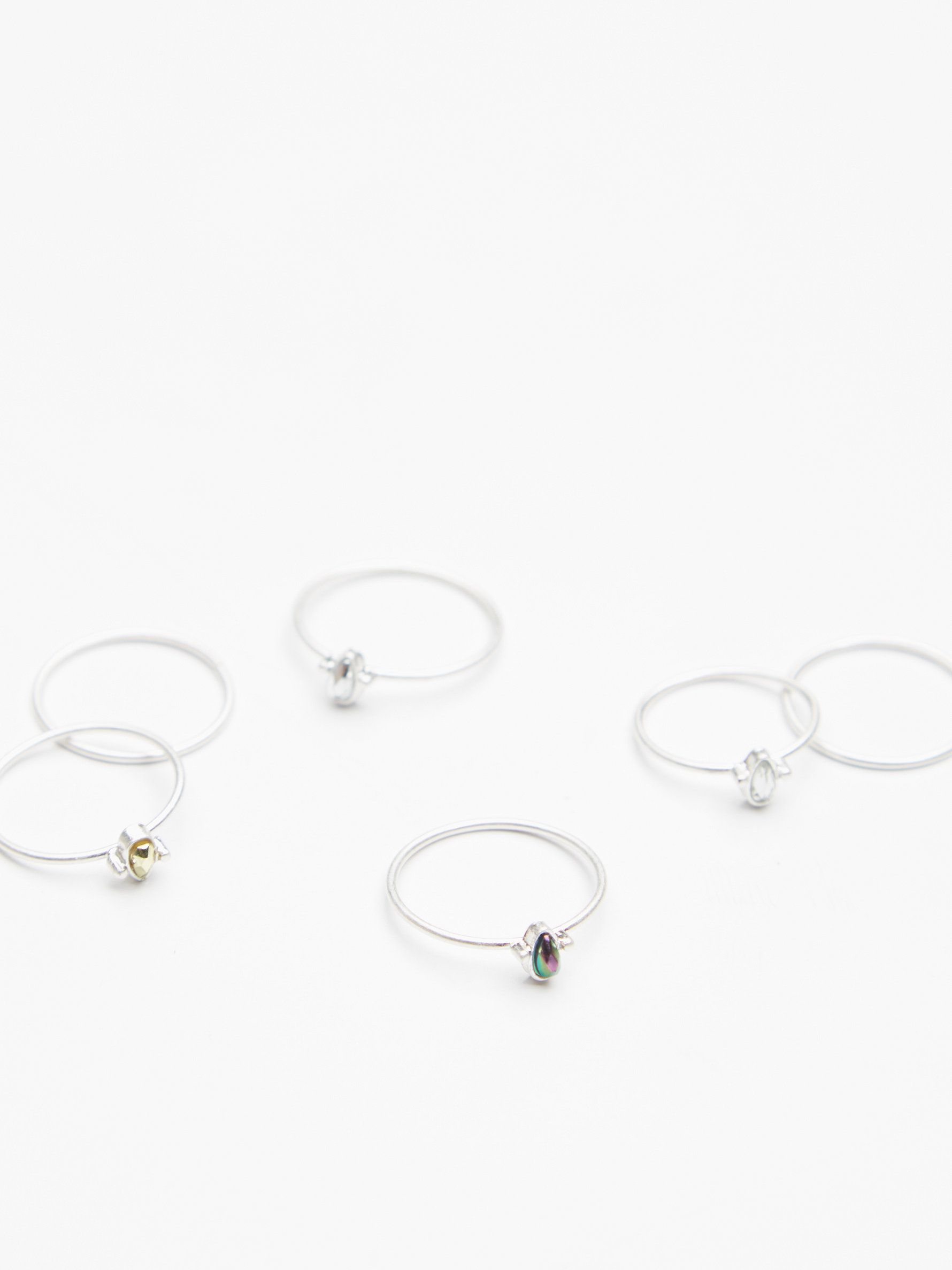 Teeny Tiny Iridescent Ring Set | Set of 6 mix-and-match metal rings featuring beautiful glass stone accents. Wear one or wear them all!