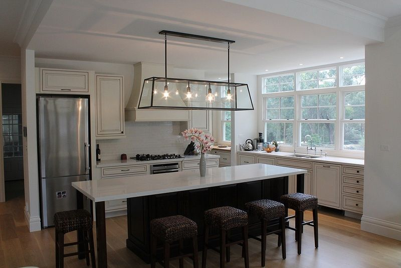 Beacon Lighting Pendant Above Island Bench In The Kitchen