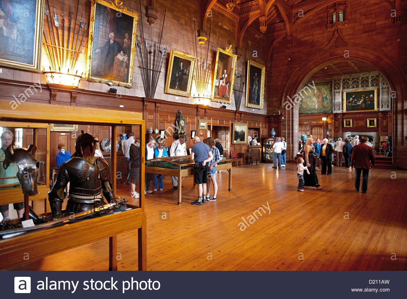 Download this stock image: Visitors in the exibition at Kings Hall in Bamburgh Castle, Bamburgh, Northumberland, England, Great Britain, Europe - D211AW from Alamy's library of millions of high resolution stock photos, illustrations and vectors.