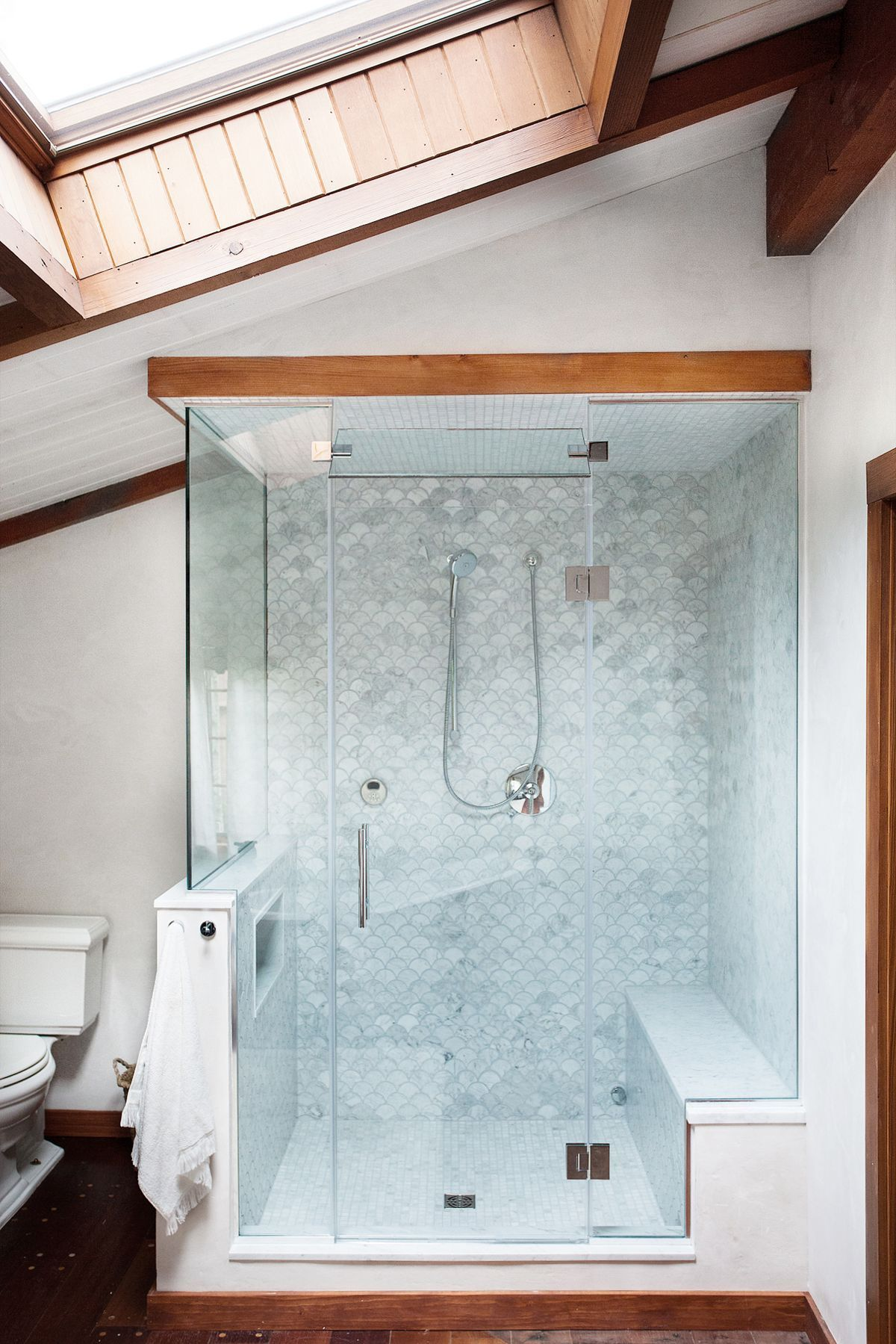 Modern glass walk-in shower with wood trim and open skylight. Photo ...