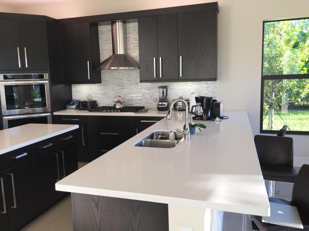 Slab kitchen cabinets  Modern Kitchen with Flush Limestone counters Ultracraft Destiny