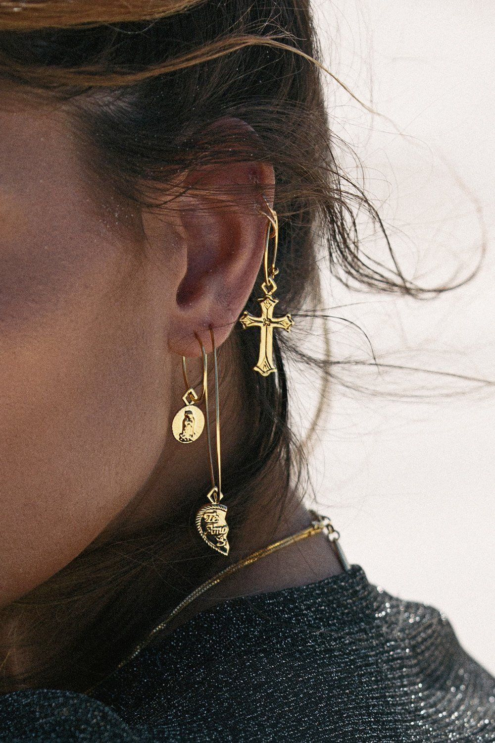 The Isidore Cross Hoops Are A Small Gold Toned Wire Hoop With Large Hanging Charm Detailing By Luv Aj X Sabo Luxe Please Note We Do Not Accept