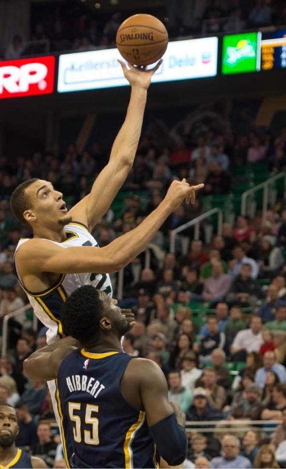 (Rick Egan  |  The Salt Lake Tribune)  Utah Jazz center Rudy Gobert (27) shoots over Indiana Pacers center Roy Hibbert (55), in NBA action, Utah vs Indiana, at EnergySolutions Arena, Monday, January 5, 2015