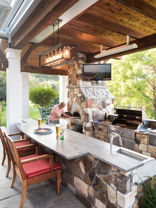 A beer and a pizza, cooked up in this home's outdoor pizza