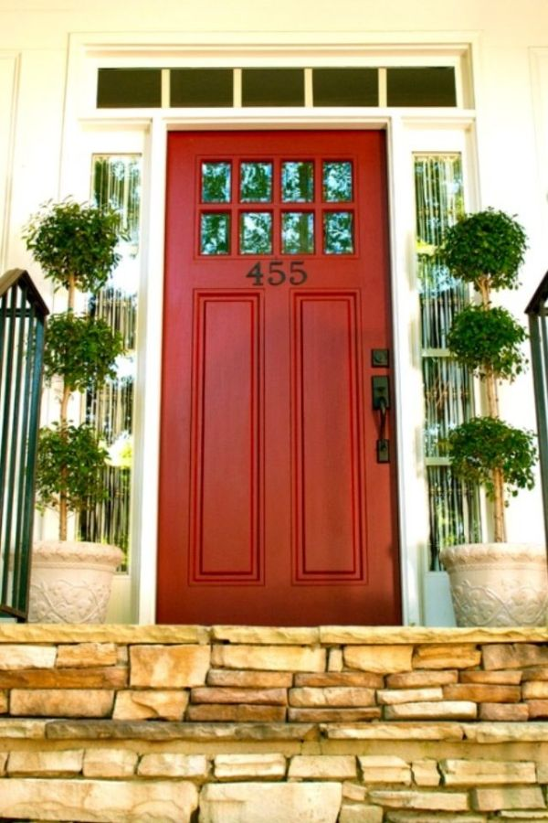 Red Front Door With Small Windows Along The Top Transom And
