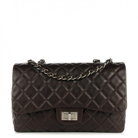 This is an authentic CHANEL Washed Lambskin Quilted Jumbo Hybrid Reissue Flap in Dark Brown. This stylish shoulder bag is crafted of luxurious diamond quilted lambskin leather in a chocolate brown.