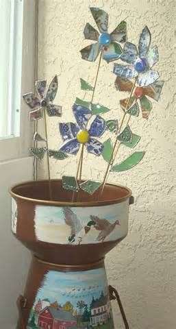 Image detail for -... garden flowers made out of various dishes and fun glass items