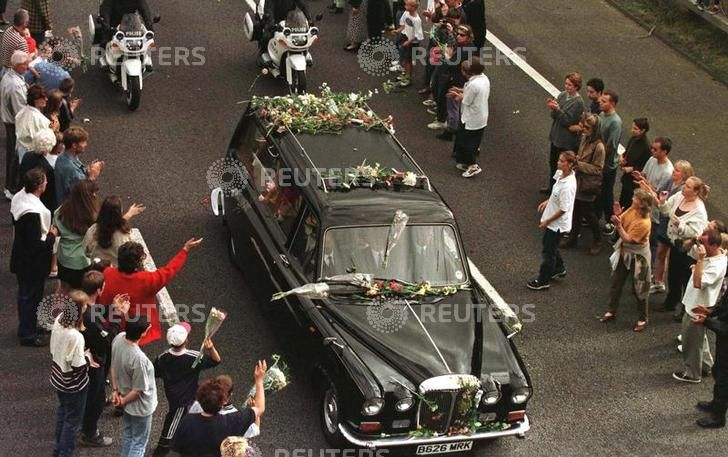 Mourners Throw Flowers Onto The Funeral Procession Of Diana