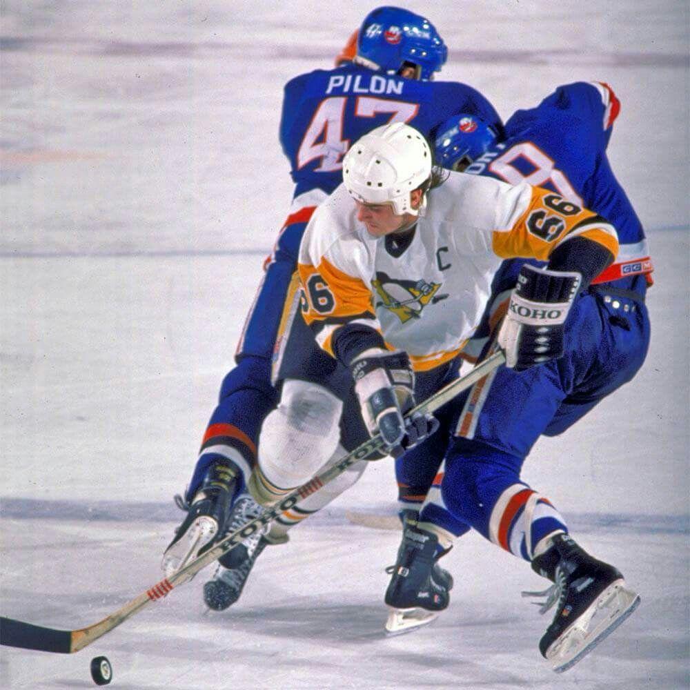 Mario Lemieux Of The Pittsburgh Penguins Skates Against The New York Islanders Pittsburgh Penguins Hockey Mario Lemieux