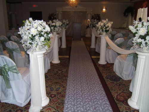 Beautiful White Pillars, Topped With Gorgeous Arrangements (with Silk Material Draped Down The