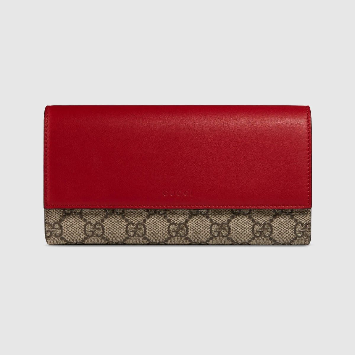 9c764b7f70b Shop the GG Supreme wallet by Gucci. A GG Supreme canvas continental wallet  with a snap closure and a multicolor leather flap.