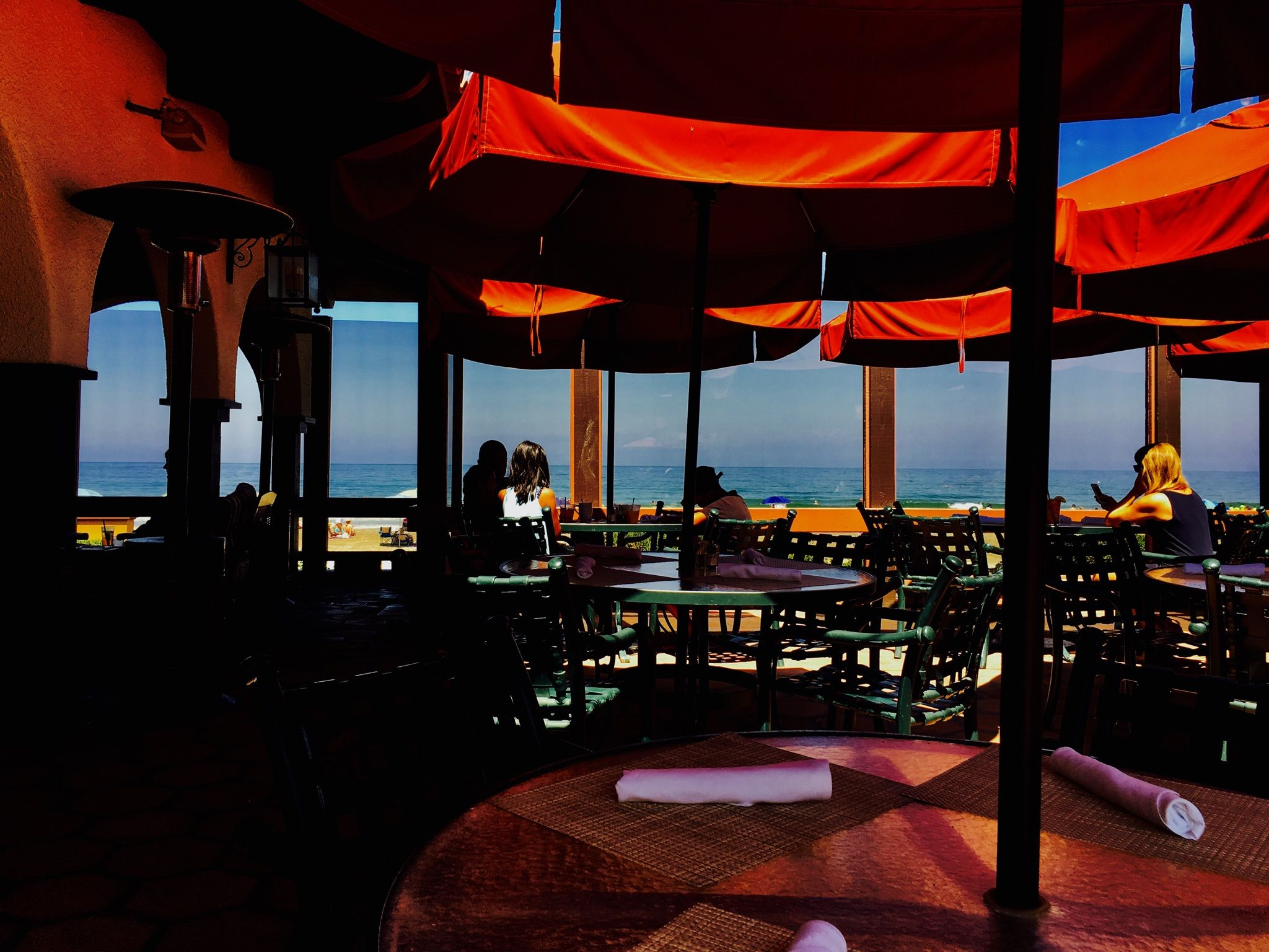 Wouldn't you rather be here, sipping cocktails and enjoying the sunshine? #TheShoresRestaurant #patiotime