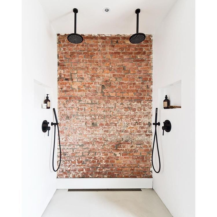 Double Shower You Don T Often See An Exposed Brick Wall In A Shower But This One Compliments The Cr Brick Bathroom Industrial Style Bathroom Bathroom Styling
