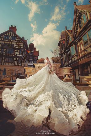 Exquisitely feminine and glamorous design from Bella Wedding Dress filled with dazzling, opulent details!