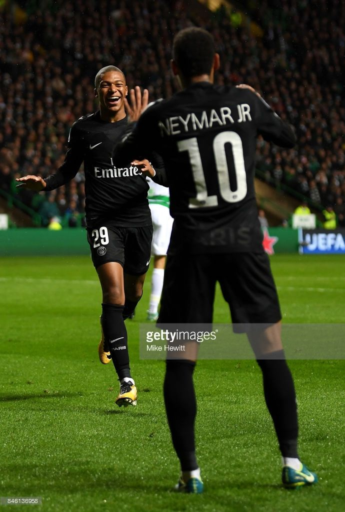 33c90327e72 Kylian Mbappe of PSG celebrates scoring his sides second goal with Neymar  of PSG during the UEFA Champions League Group B match between Celtic and  Paris ...