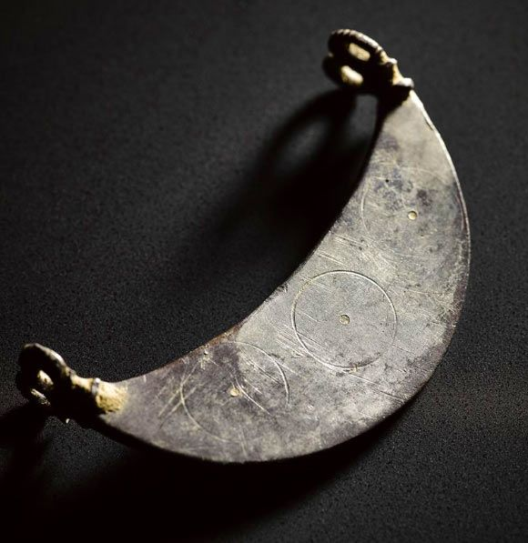 Silver crescent from the Aberdeenshire hoard. Image credit: © National Museum Scotland.