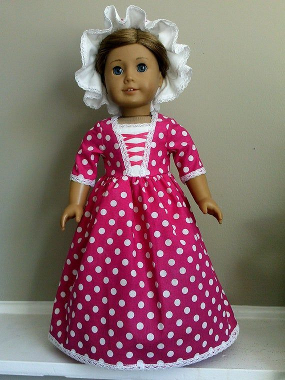 Colonial Bright Pink Polka Dot Day Dress with Mob Cap for 18 Inch or AG Felicity or Elizabeth Doll #colonialdolldresses This Colonial evening dress is made from a bright pink polka dot cotton and our original one piece Colonial day dress pattern.  The stomacher is cut from white cotton muslin fabric and s crossed with bright pink grosgrain ribbons. The top and sides of the bodice are trimmed with white cluny lace. #colonialdolldresses