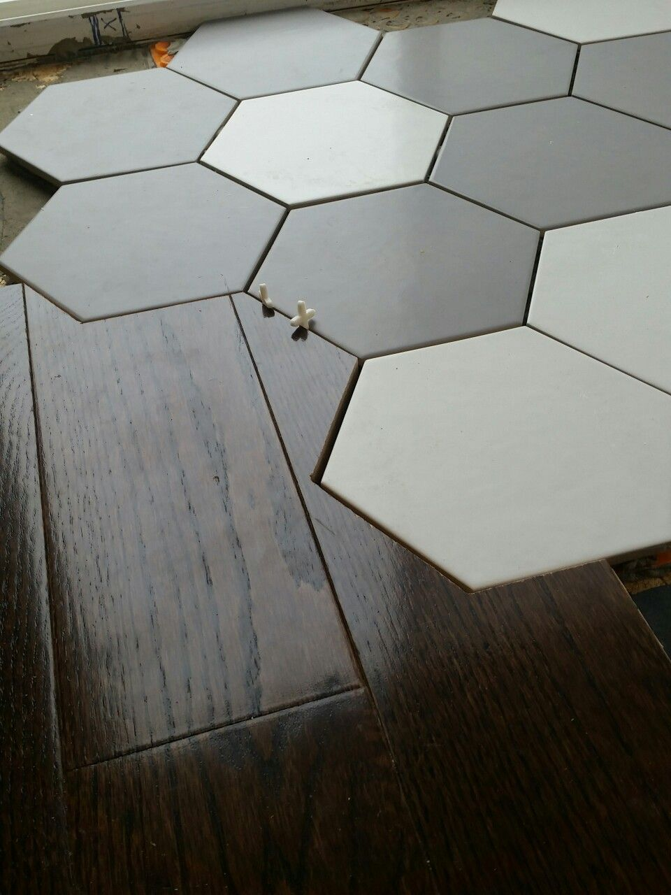 My Kitchen Floor Install I Used A Hexagonal Tile And Made My Hardwood Blend Into It Flooring House Flooring Kitchen Flooring